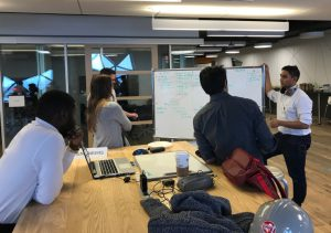 Engineering students at York University collaborating around a whiteboard.