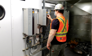 Modern Niagara employee working on an electrical box