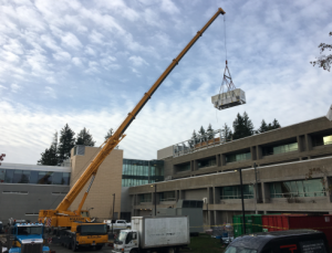 An air handling unit (AHU) being lifted to the roof of the Surrey Court House