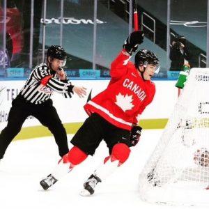 Tyson Stewart indicates a goal scored for Team Canada.