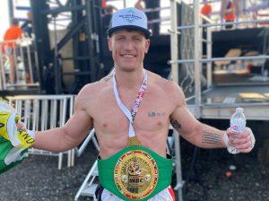 Mark MacKinnon with the WBC Muay Thai Canadian Cruiserweight Championship Belt
